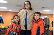 woman smiles with two young boys winter warmup 2018 new neighborhoods