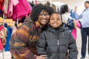 woman and young boy smile at winter warmup 2018 new neighborhoods