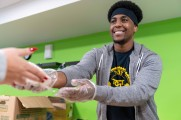 man serves food at winter warm up 2018 new neighborhoods