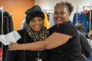 women smile at winter warm up 2018 new neighborhoods