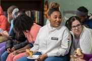 young women eat food at winter warm up 2018 new neighborhoods
