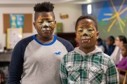two boys with face paint at winter warmup new neighborhoods