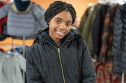 young girl smiles at 2018 winter warmup new neighborhoods