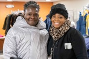 two women smile at winter warmup 2018 new neighborhoods