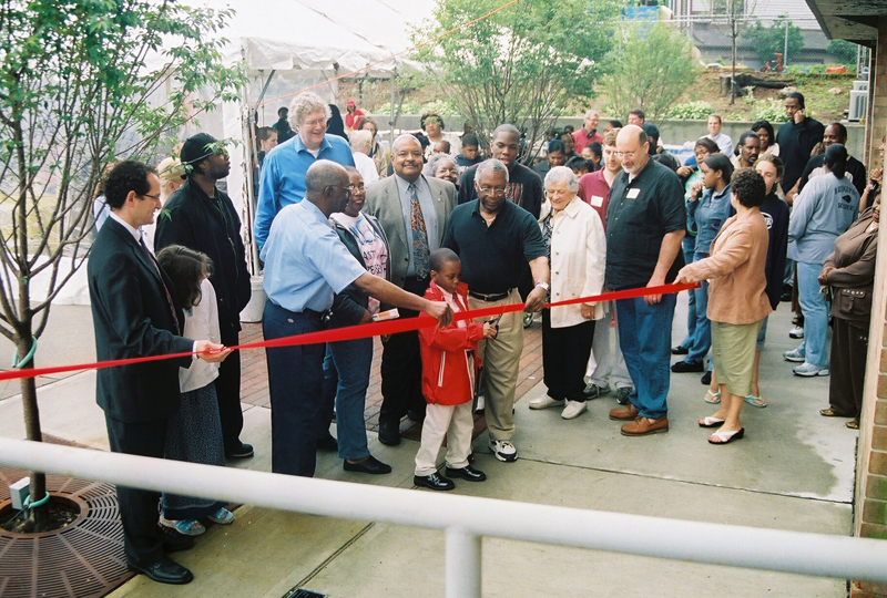 Ribbon cutting for rededication of MLK Jr, Apartments
