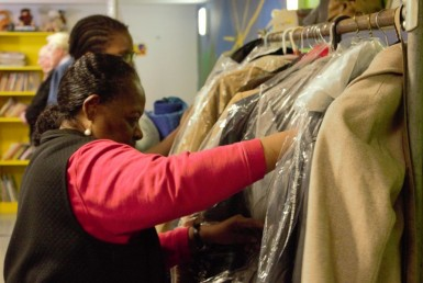 Women looking at coats during winter warm up