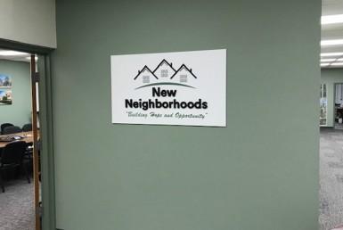 New Neighborhoods wall sign