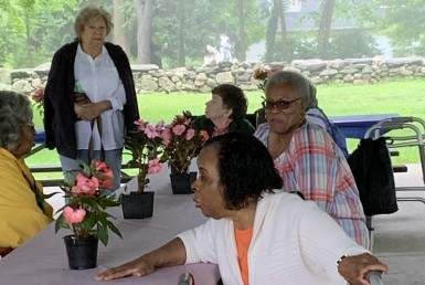 Women sitting at a table during senior sizzle