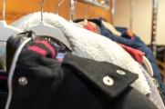 Closeup of woman's coats on a rack