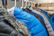 Closeup of men's coats on a rack