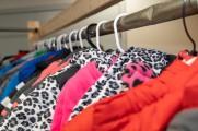 Closeup of children's coats on a rack
