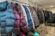 Three racks of coats during New Neighborhood's winter warm up