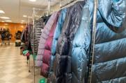 Multiple racks of coats during New Neighborhood's winter warm up