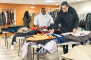Employees of New Neighborhoods organizing coats for a giveaway